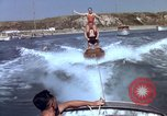 Image of motorboat pulling man and woman balanced on aquaplane United States USA, 1939, second 26 stock footage video 65675051556