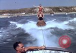 Image of motorboat pulling man and woman balanced on aquaplane United States USA, 1939, second 29 stock footage video 65675051556