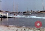 Image of motorboat pulling man and woman balanced on aquaplane United States USA, 1939, second 31 stock footage video 65675051556
