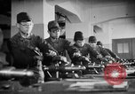 Image of Japanese workers in munitions factories Japan, 1943, second 62 stock footage video 65675051698