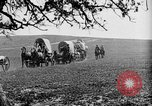 Image of horse drawn covered wagons United States USA, 1918, second 39 stock footage video 65675051805