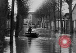 Image of flooded streets Charenton France, 1930, second 13 stock footage video 65675052007