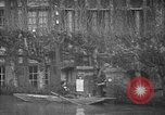 Image of flooded streets Charenton France, 1930, second 19 stock footage video 65675052007