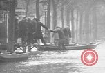 Image of flooded streets Charenton France, 1930, second 23 stock footage video 65675052007