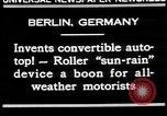 Image of man driving car Berlin Germany, 1930, second 5 stock footage video 65675052012
