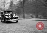 Image of man driving car Berlin Germany, 1930, second 12 stock footage video 65675052012