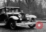 Image of man driving car Berlin Germany, 1930, second 13 stock footage video 65675052012