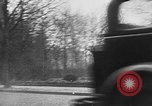 Image of man driving car Berlin Germany, 1930, second 14 stock footage video 65675052012