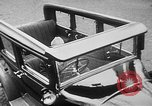 Image of man driving car Berlin Germany, 1930, second 15 stock footage video 65675052012