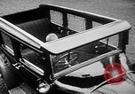 Image of man driving car Berlin Germany, 1930, second 16 stock footage video 65675052012