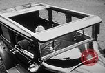Image of man driving car Berlin Germany, 1930, second 17 stock footage video 65675052012