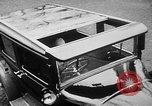 Image of man driving car Berlin Germany, 1930, second 18 stock footage video 65675052012