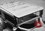 Image of man driving car Berlin Germany, 1930, second 19 stock footage video 65675052012