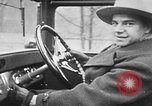Image of man driving car Berlin Germany, 1930, second 23 stock footage video 65675052012