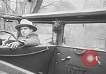 Image of man driving car Berlin Germany, 1930, second 28 stock footage video 65675052012