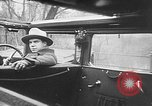 Image of man driving car Berlin Germany, 1930, second 29 stock footage video 65675052012