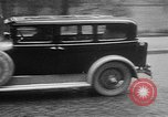 Image of man driving car Berlin Germany, 1930, second 37 stock footage video 65675052012