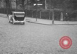 Image of man driving car Berlin Germany, 1930, second 40 stock footage video 65675052012