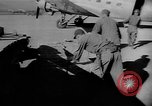 Image of C-47 aircraft dropping propaganda leaflets Korea, 1950, second 13 stock footage video 65675052163