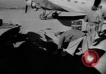 Image of C-47 aircraft dropping propaganda leaflets Korea, 1950, second 16 stock footage video 65675052163