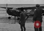 Image of U.S. Army pilots fly Stinson L-5 Sentinal airplane  Palawan Philippines, 1945, second 19 stock footage video 65675052254