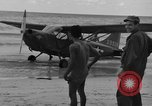 Image of U.S. Army pilots fly Stinson L-5 Sentinal airplane  Palawan Philippines, 1945, second 20 stock footage video 65675052254