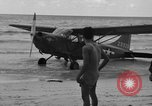 Image of U.S. Army pilots fly Stinson L-5 Sentinal airplane  Palawan Philippines, 1945, second 22 stock footage video 65675052254