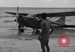 Image of U.S. Army pilots fly Stinson L-5 Sentinal airplane  Palawan Philippines, 1945, second 23 stock footage video 65675052254
