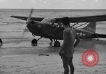 Image of U.S. Army pilots fly Stinson L-5 Sentinal airplane  Palawan Philippines, 1945, second 24 stock footage video 65675052254