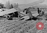 Image of Crashed Piper Cub (L-4) airplane prepared for towing Italy, 1944, second 48 stock footage video 65675052267