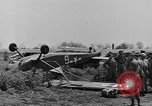 Image of Inverted US Army Stinson L-5 plane on field Italy, 1944, second 21 stock footage video 65675052268