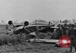Image of Inverted US Army Stinson L-5 plane on field Italy, 1944, second 23 stock footage video 65675052268