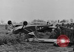 Image of Inverted US Army Stinson L-5 plane on field Italy, 1944, second 24 stock footage video 65675052268