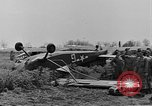 Image of Inverted US Army Stinson L-5 plane on field Italy, 1944, second 25 stock footage video 65675052268
