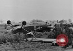 Image of Inverted US Army Stinson L-5 plane on field Italy, 1944, second 26 stock footage video 65675052268