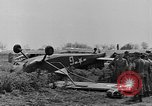 Image of Inverted US Army Stinson L-5 plane on field Italy, 1944, second 27 stock footage video 65675052268