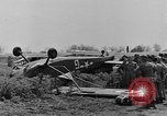 Image of Inverted US Army Stinson L-5 plane on field Italy, 1944, second 28 stock footage video 65675052268