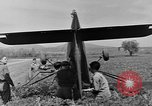 Image of Inverted US Army Stinson L-5 plane on field Italy, 1944, second 38 stock footage video 65675052268