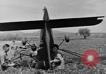 Image of Inverted US Army Stinson L-5 plane on field Italy, 1944, second 39 stock footage video 65675052268