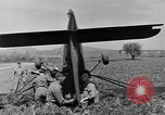 Image of Inverted US Army Stinson L-5 plane on field Italy, 1944, second 40 stock footage video 65675052268