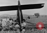 Image of Inverted US Army Stinson L-5 plane on field Italy, 1944, second 41 stock footage video 65675052268