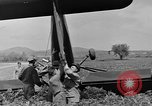 Image of Inverted US Army Stinson L-5 plane on field Italy, 1944, second 42 stock footage video 65675052268