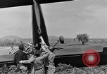 Image of Inverted US Army Stinson L-5 plane on field Italy, 1944, second 43 stock footage video 65675052268