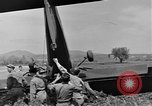 Image of Inverted US Army Stinson L-5 plane on field Italy, 1944, second 44 stock footage video 65675052268