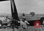 Image of Inverted US Army Stinson L-5 plane on field Italy, 1944, second 45 stock footage video 65675052268