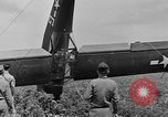 Image of Inverted US Army Stinson L-5 plane on field Italy, 1944, second 47 stock footage video 65675052268