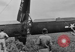Image of Inverted US Army Stinson L-5 plane on field Italy, 1944, second 48 stock footage video 65675052268