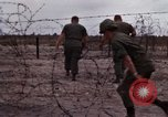 Image of United States officer Vietnam Bien Hoa Air Base, 1968, second 18 stock footage video 65675052304