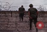 Image of United States officer Vietnam Bien Hoa Air Base, 1968, second 19 stock footage video 65675052304