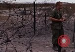 Image of United States officer Vietnam Bien Hoa Air Base, 1968, second 57 stock footage video 65675052304